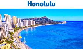 Honolulu, HI - blue water beach with volcano in background
